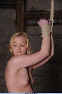 Blonde slave tied in the barn