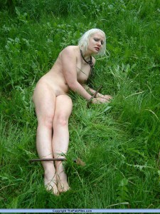 Blonde slave bound outdoors