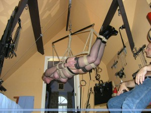 Slave girl in suspension bondage