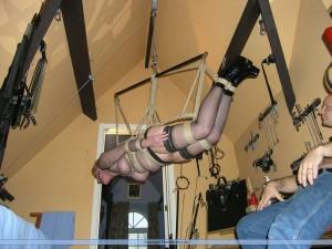 Slave girl in suspension bondage