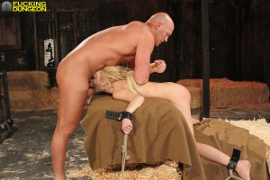 Blonde slave bound giving blow job