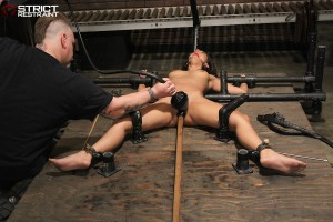 Brunette slave securely bound in steel