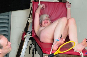 Blonde submissive in foot torture